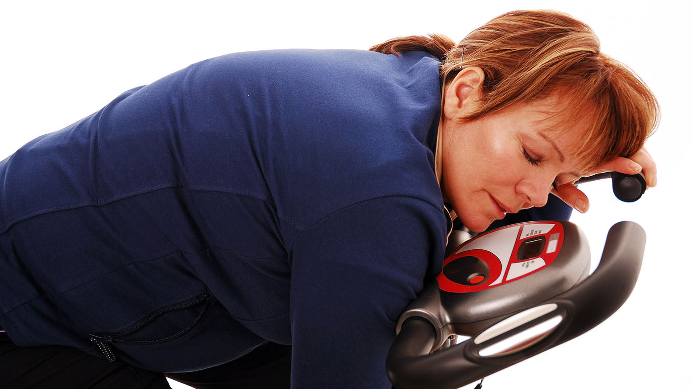 woman asleep on treadmill