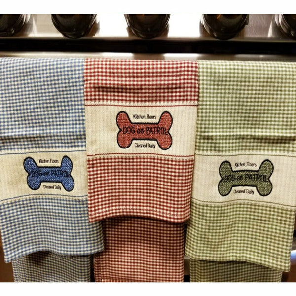 Cute embroidered Dog On Patrol kitchen or bath towels with dog bone.