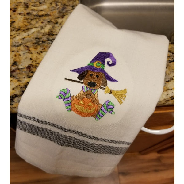 Halloween dog with pumpkin kitchen or hand towel embroidered.