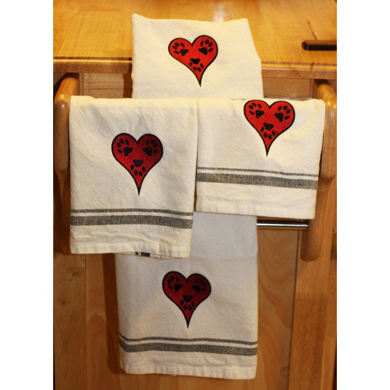 Embroidered heart and paw print kitchen towels.
