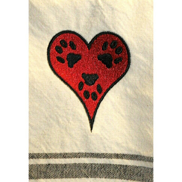 Heart and paw print kitchen towels close up.