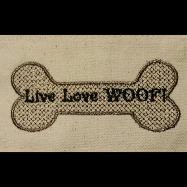 Live Love Woof bone embroidery close up.