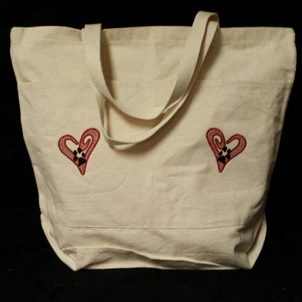 Large open heart with paw print tote bag.