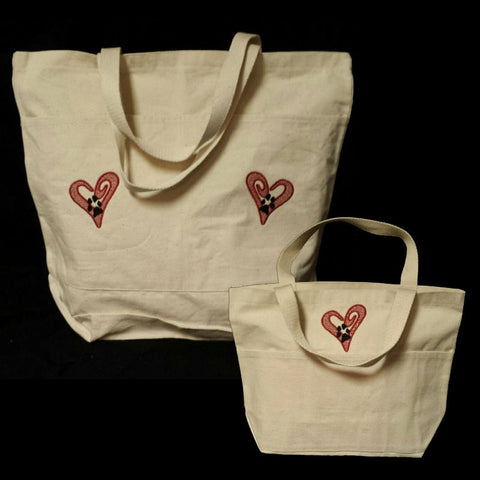 Open heart with paw print pet lovers tote bag.