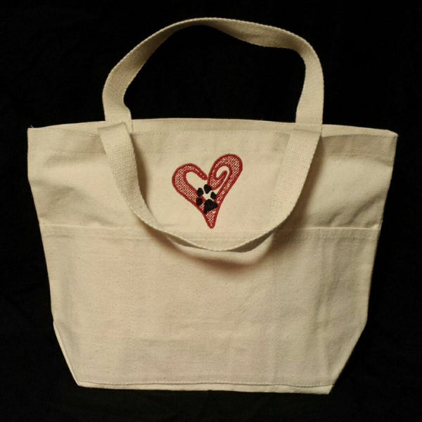 Small open heart with paw print tote bag.