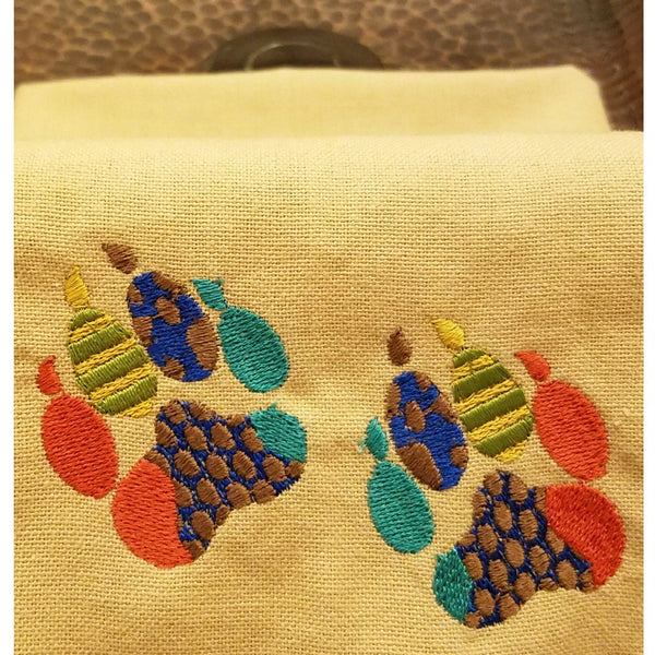 Embroidered paw prints on kitchen towels
