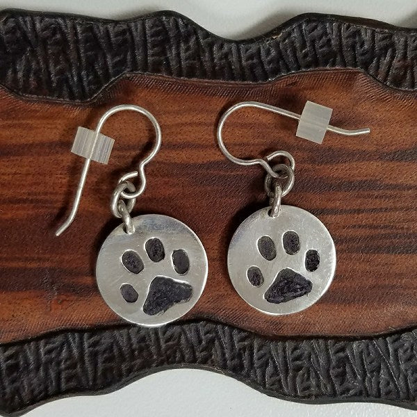 Solid sterling silver paw print earrings for pet lovers.