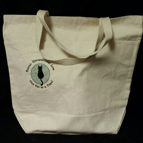 A rescue cat embroidered tote bag. Show your support.