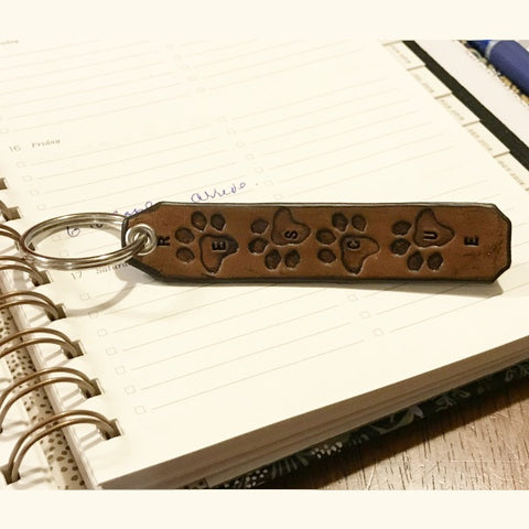 Animal rescue key fob hand made of leather with paw prints.