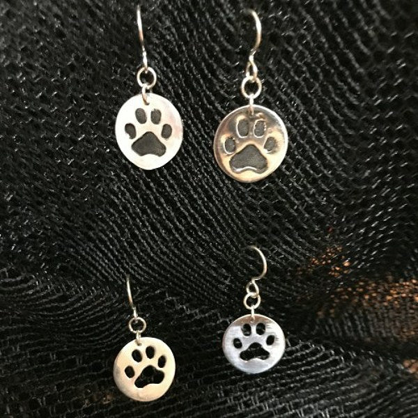 Sterling silver paw print earrings from our pet lovers jewelry collection.
