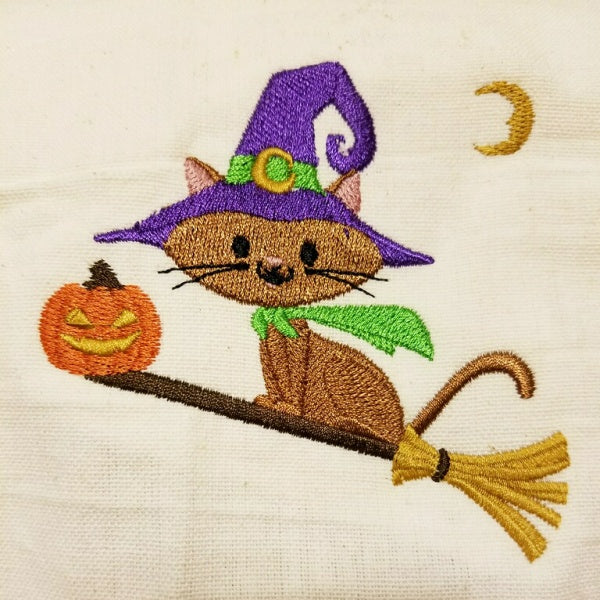 Halloween cat towel embroidered with a cat witch on a broom.