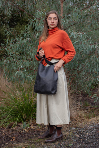 Model wears Ripple and Co Leather Cross Shoulder Jude Bag Black