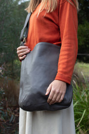Model wears Ripple and Co Jude Leather Cross Shoulder Bag Elephant Grey