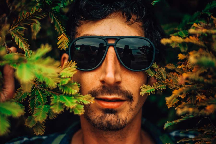 charcoal_grey Ombraz Armless Sunglasses - Ombraz solve what frustrates you about sunglasses. Handmade frames attach directly to an adjustable cord that keeps the sunglasses securely & comfortably in place. 2019 Sunglass of the year from Backpacker Magazine, Ombraz are lightweight, easy to pack & stow & are equipped with world-class polarized Zeiss lenses. Armless sunglasses with a built-in cord.