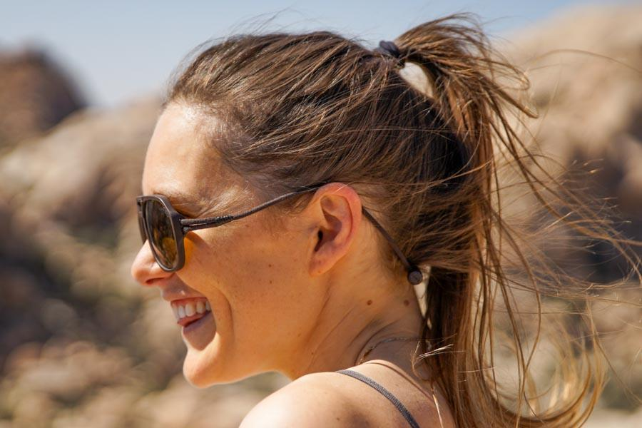 MATTEBROWN_BROWN Ombraz Armless Sunglasses - Ombraz solve what frustrates you about sunglasses. Handmade frames attach directly to an adjustable cord that keeps the sunglasses securely & comfortably in place. 2019 Sunglass of the year from Backpacker Magazine, Ombraz are lightweight, easy to pack & stow & are equipped with world-class polarized Zeiss lenses. Armless sunglasses with a built-in cord.