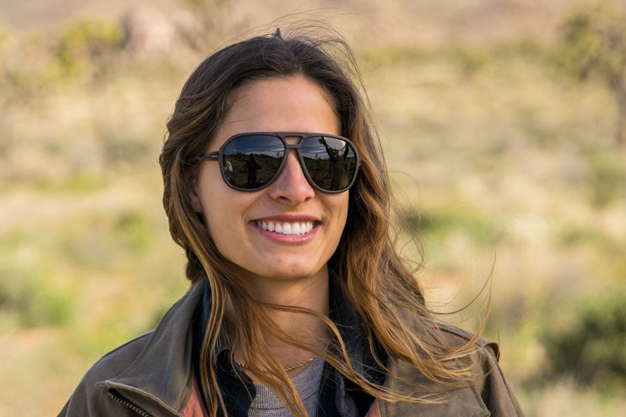 MATTEBROWN_GREY Ombraz Armless Sunglasses - Ombraz solve what frustrates you about sunglasses. Handmade frames attach directly to an adjustable cord that keeps the sunglasses securely & comfortably in place. 2019 Sunglass of the year from Backpacker Magazine, Ombraz are lightweight, easy to pack & stow & are equipped with world-class polarized Zeiss lenses. Armless sunglasses with a built-in cord.