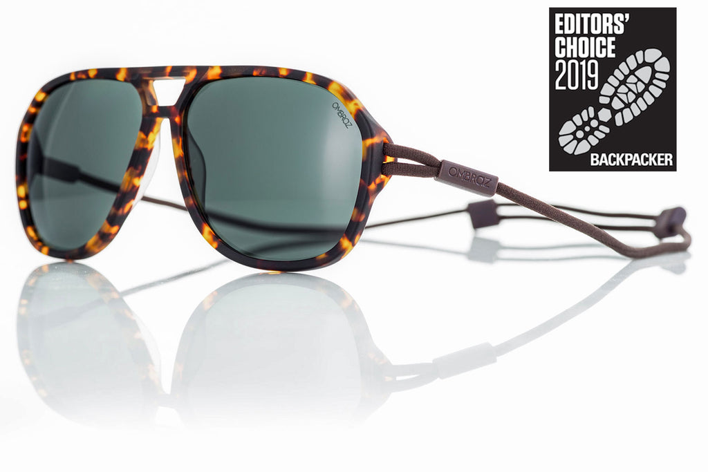Tortoise_grey Ombraz Armless Sunglasses attach directly to a minimalist, adjustable cord that keeps them securely and comfortably in place. 2019 Sunglass of the year from Backpacker Magazine, Ombraz are lightweight, never fall off, easy to pack & stow & are equipped with world-class polarized Zeiss lenses. Armless sunglasses with a built-in cord.