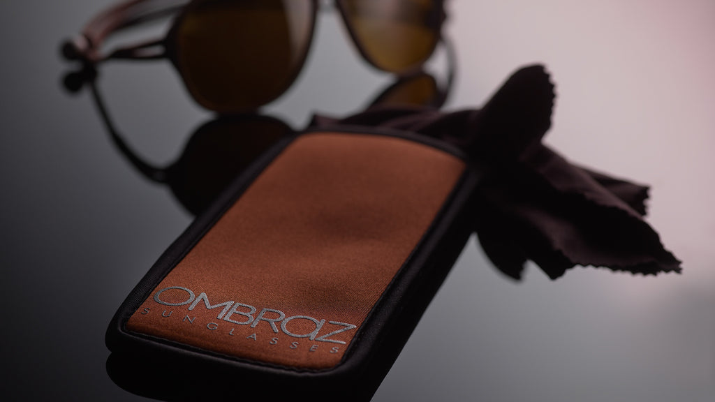 Neoprene Case with Built-In Microfiber - Ombraz solve what frustrates you about sunglasses. Handmade frames attach directly to an adjustable cord that keeps the sunglasses securely & comfortably in place. 2019 Sunglass of the year from Backpacker Magazine, Ombraz are lightweight, easy to pack & stow & are equipped with world-class polarized Zeiss lenses. Armless sunglasses with a built-in cord.