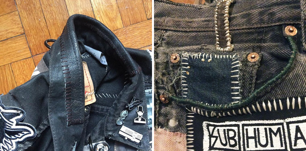 various canvas and leather patches on a black jacket and denim pants