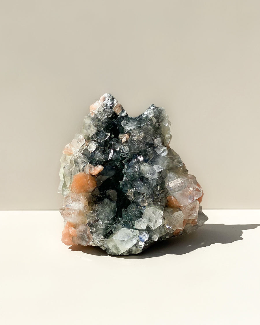 Clear Apophyllite and Peach Stilbite on Black Chalcedony