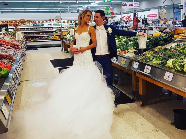 Couple does a wedding photoshoot in the very supermarket where they met