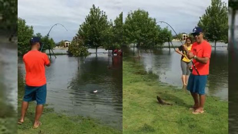 Perth couple land a carp in the park after big rains flood lake