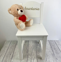 chair with a teddy on