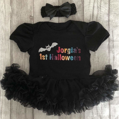 Personalised 1st Bat Halloween baby girl tutu romper suit with headband. little secrets clothing makes the cutest tutu romper with matching headband. personalised specifically for halloween. it makes the perfect halloween outfit for your baby girl. Buy from little secrets clothing to make sure you're getting affordable, money savings outfits but of the highest quality alike high end designers such as YSL, jimmy Choo, Versace, Burberry, Valentino, Yves saint Laurent, Jimmy Choo