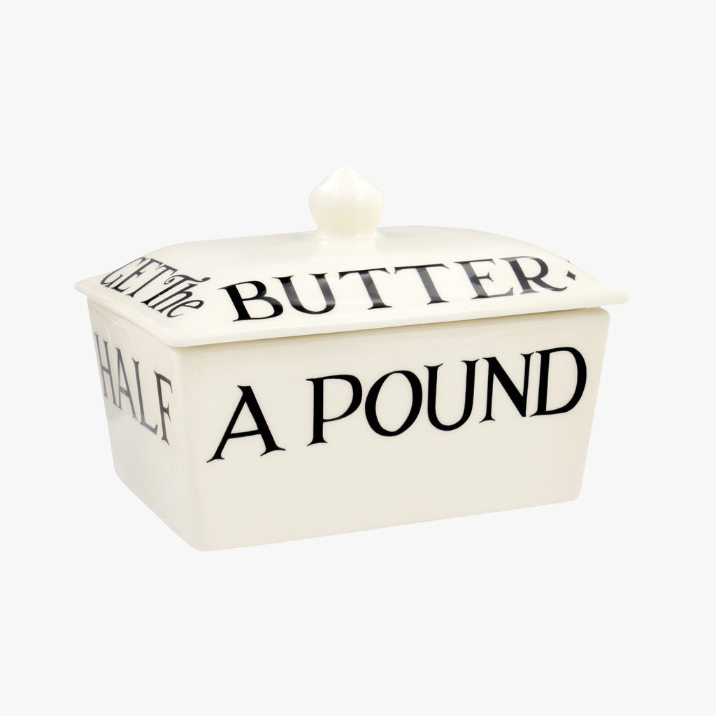 "Emma Bridgewater Black Toast Small Butter Dish - Half a pound, minimalist style, rectangular, ceramic butter dish with lid. Hand decorated with black letterings spelling ""Half A POUND of BEST BUTTER."" on the outside and ""DON't LET THE CAT GET The BUTTER"" on the lid."
