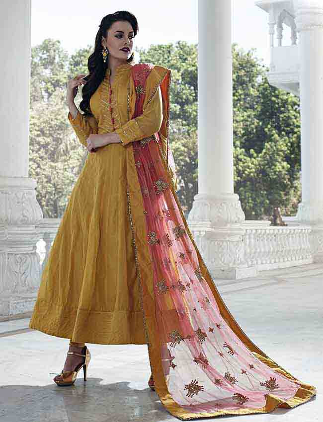 Mustard yellow anarkali with zari embroidery and gotta lace.