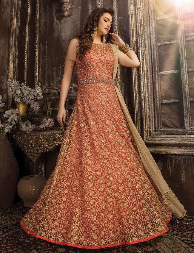Rust traditional gown with zari embroidery and handwork