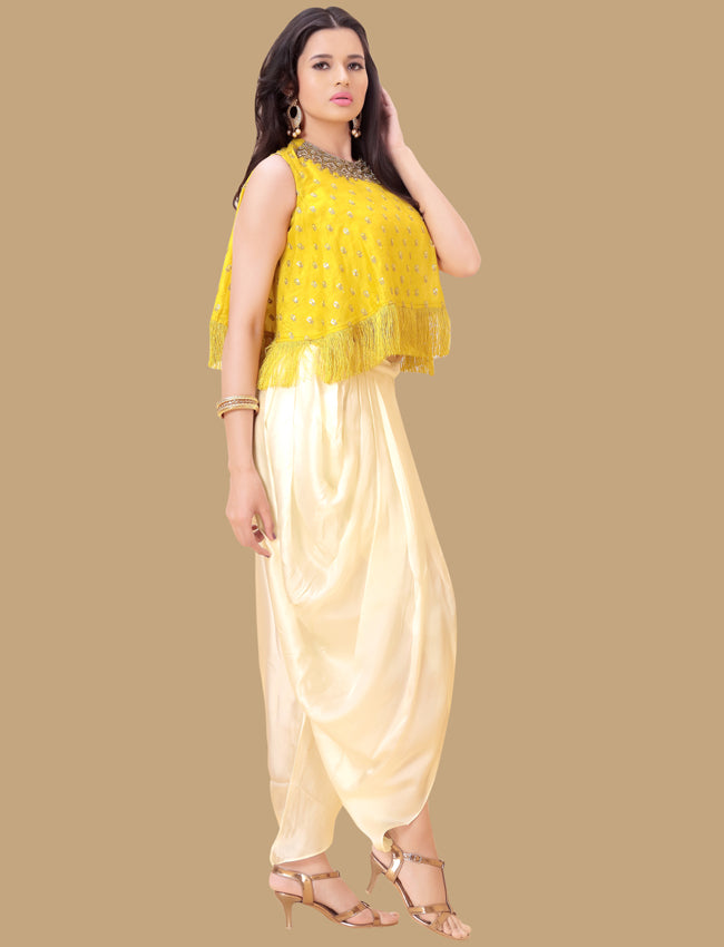 Yellow dhoti style suit with cutdana beads and sequins embellishment