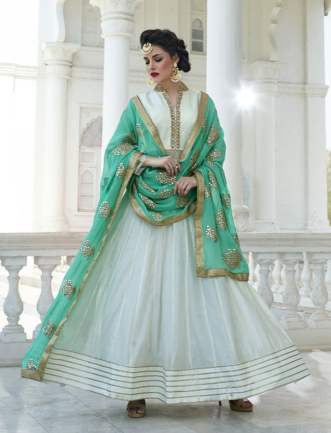 White anarkali with embroidery and gotta patti
