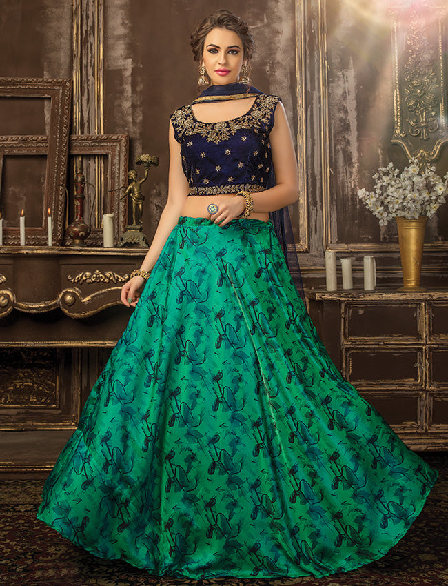 Navy blue turquoise crop top and printed lehenga with cutdana zardosi embellishment
