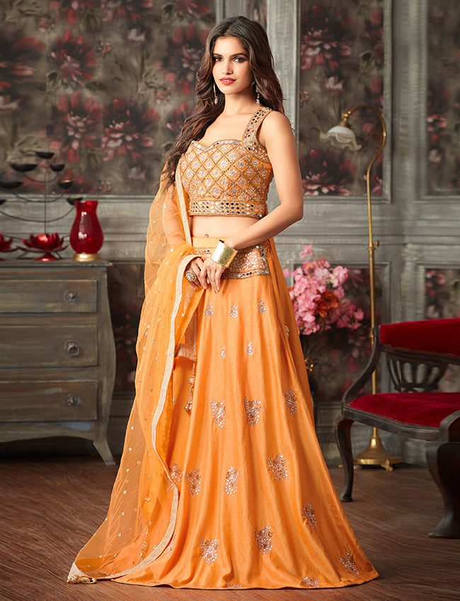 Orange crop top lehenga embroidered with mirror kundan and gotta patti