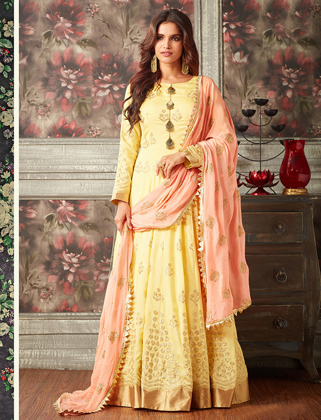 Yellow traditional gown with zari embroidery