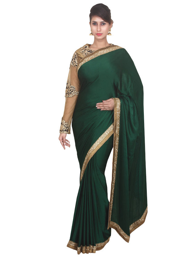 Bottle green satin saree with cutdana border.
