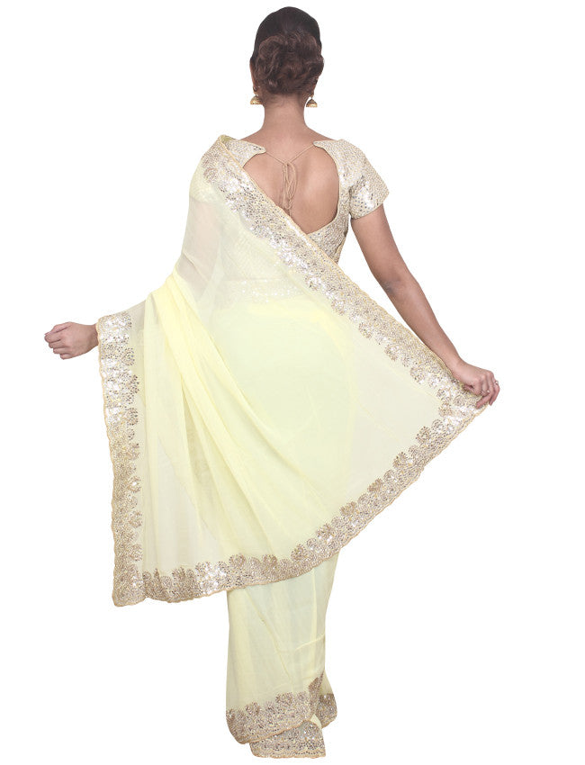 Lemon yellow georgette saree with mirror work