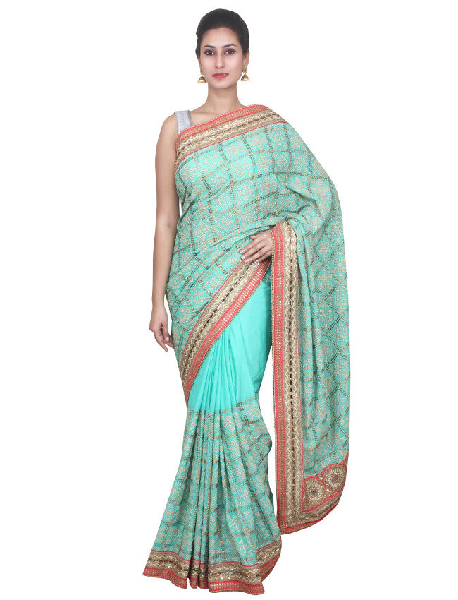 Sea green saree with machine embroidery and zari cording