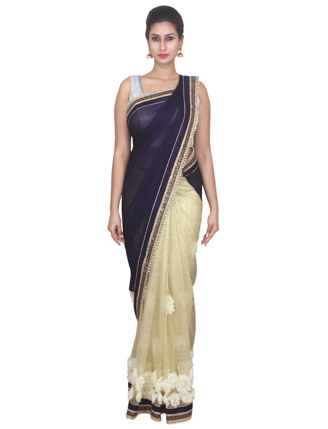 Beige navy blue half and half saree with floral patchwork