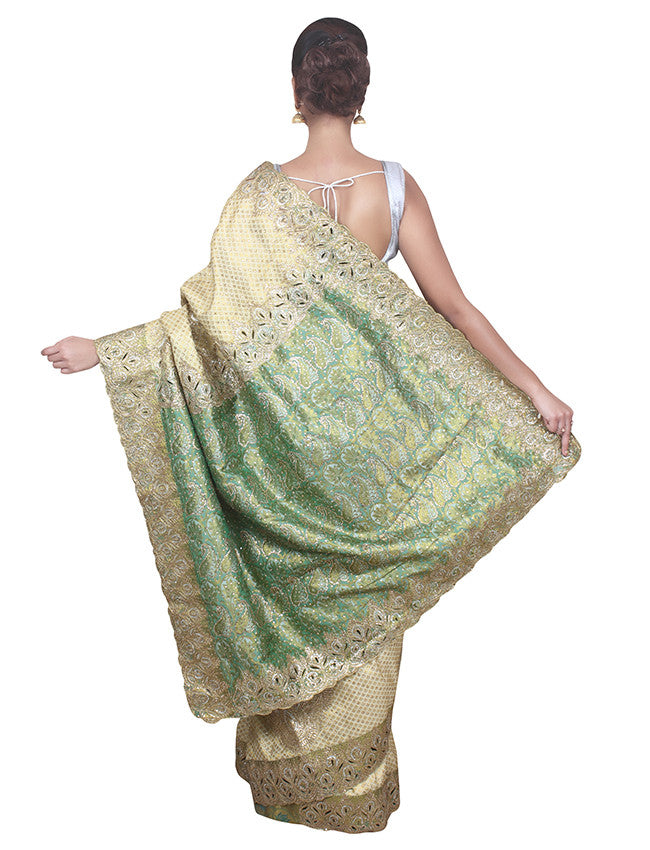 Beige and dusty green saree with kundan and zari embroidery