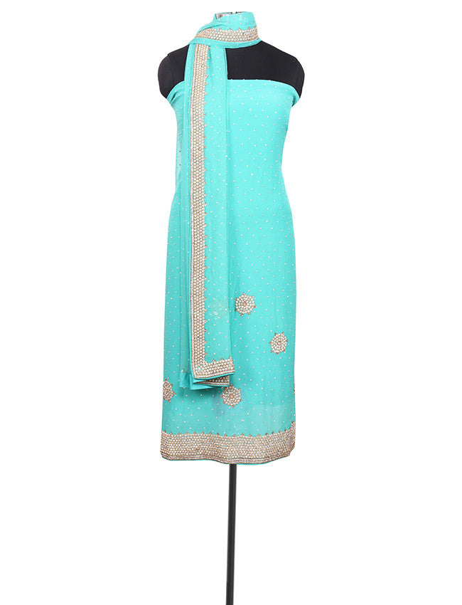 Turquoise unstitched suit with diamante work