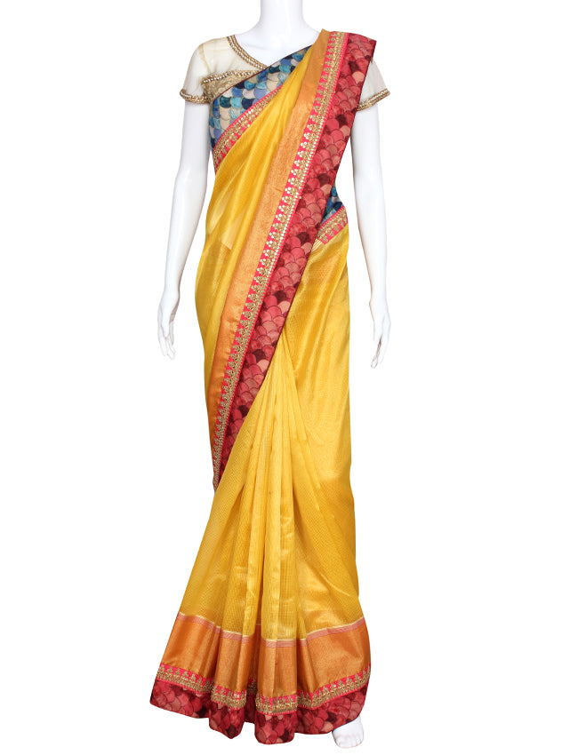 Yellow party wear saree with zari cording border