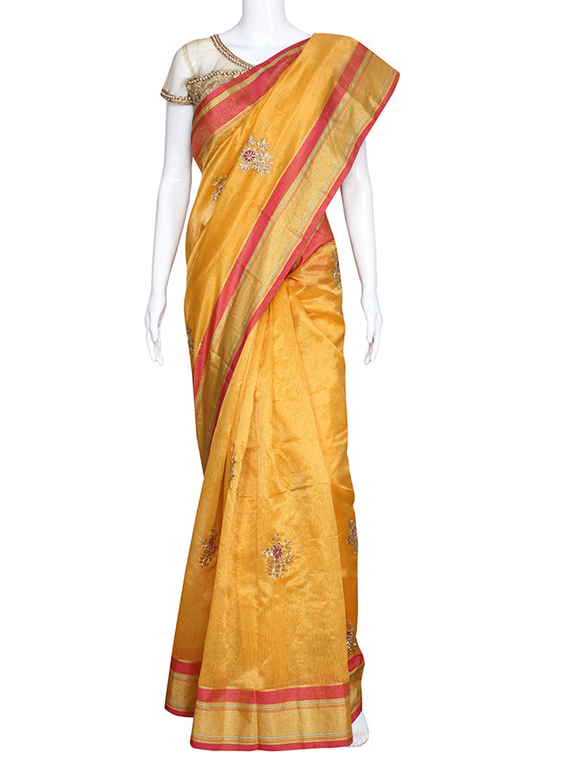 Yellow party wear saree with zari cording