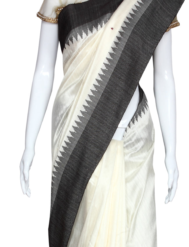 Off white party wear saree with metal mirror work and printed pallu