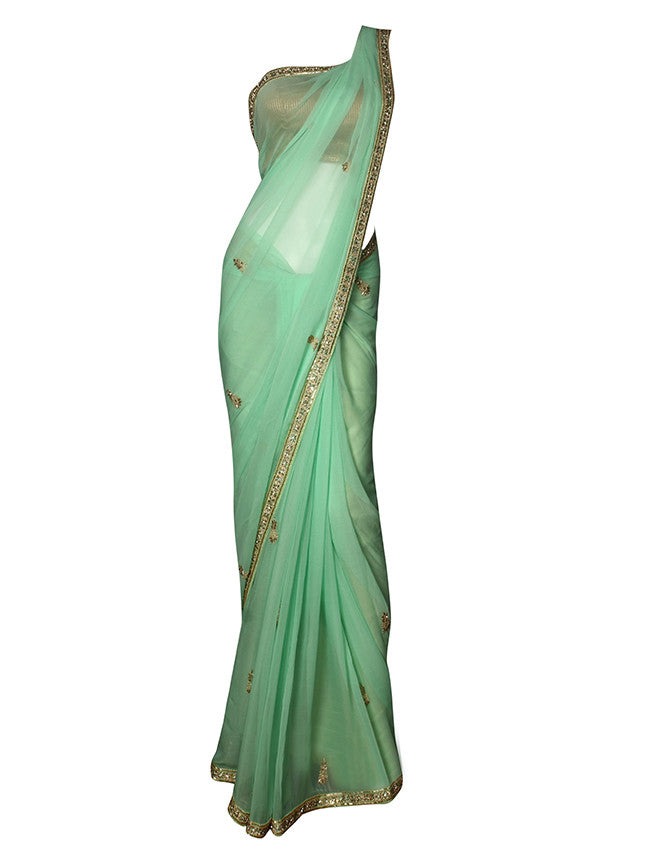 Pista green party wear saree with cutdana and diamante work