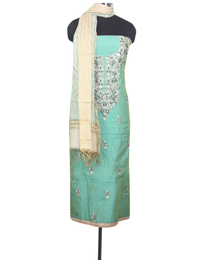 Sea green unstitched suit with embroidery and handwork