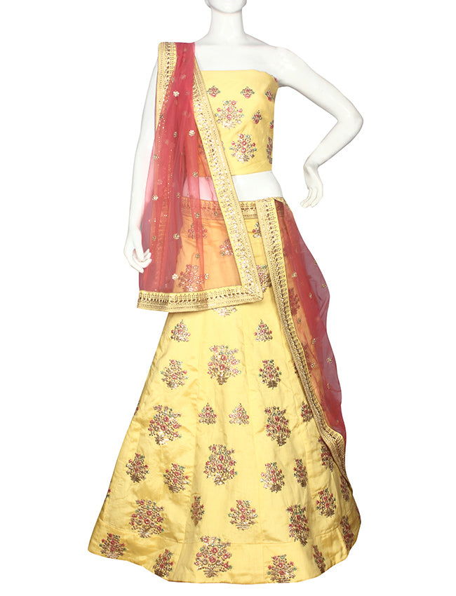 Yellow unstitched lehenga with sequins zari and thread embroidery