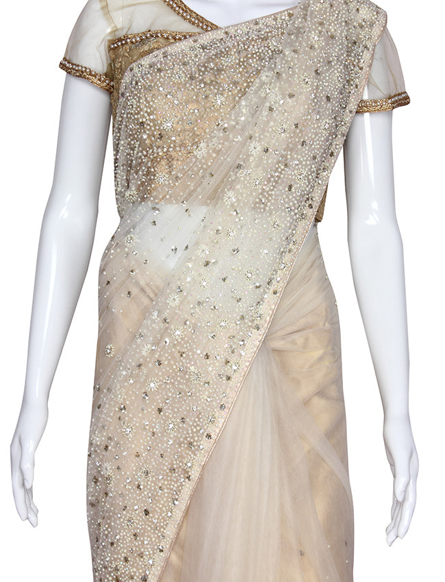 Off white party wear saree with sequins pearl and cutdana work