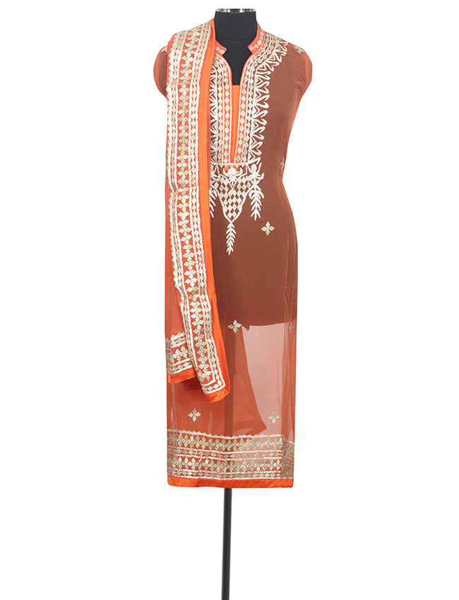 Orange semistitched suit with gotta patti and lace work